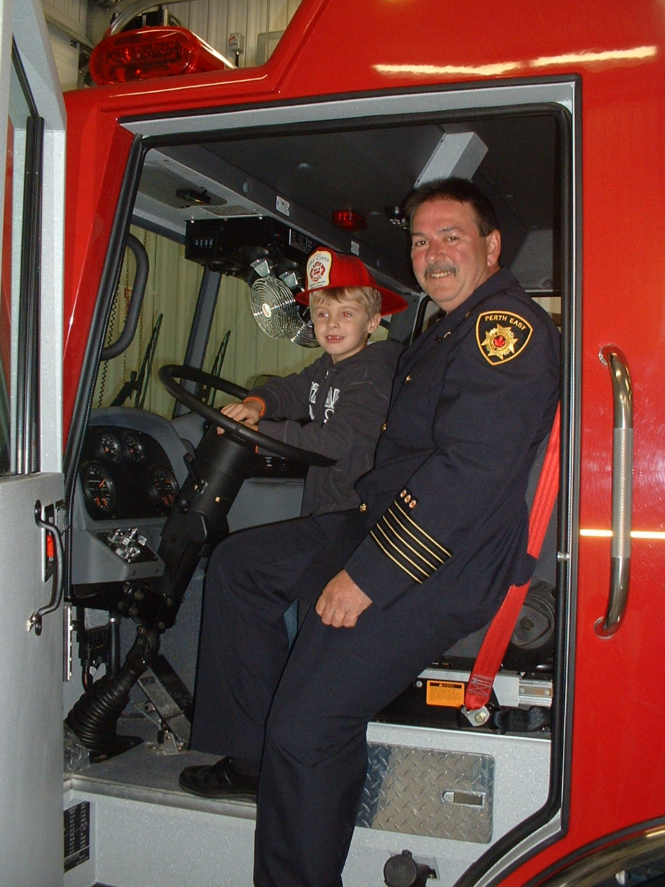 Station Chief and Junior Fire Chief in Truck