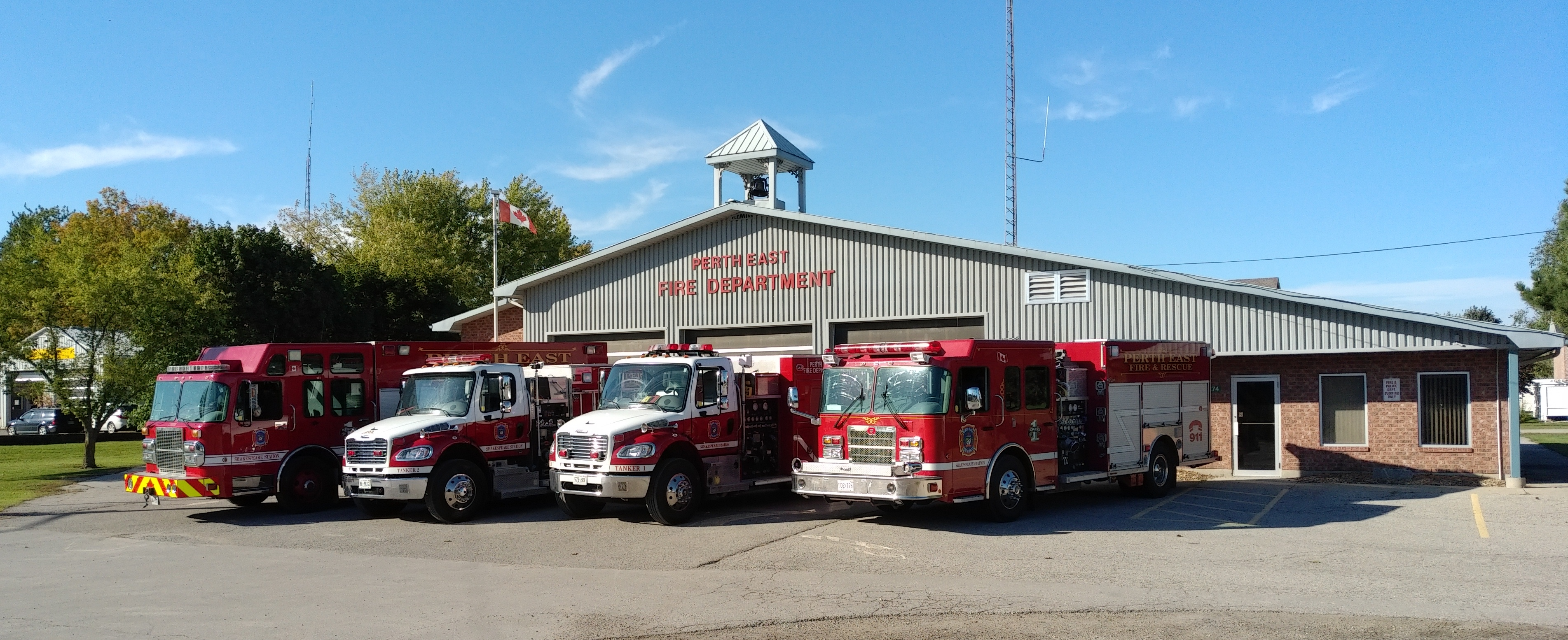 Shakespeare Fire Station with 4 fire apparatus sitting outside